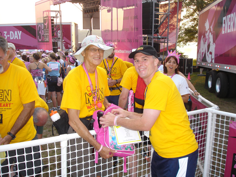George getting his pink backpack filled with supplies (George is walk all 12 Komen walks)