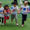 Some young Korean girls compete in a relay event.