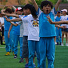 A shot of Korean students stretching before the sports events.