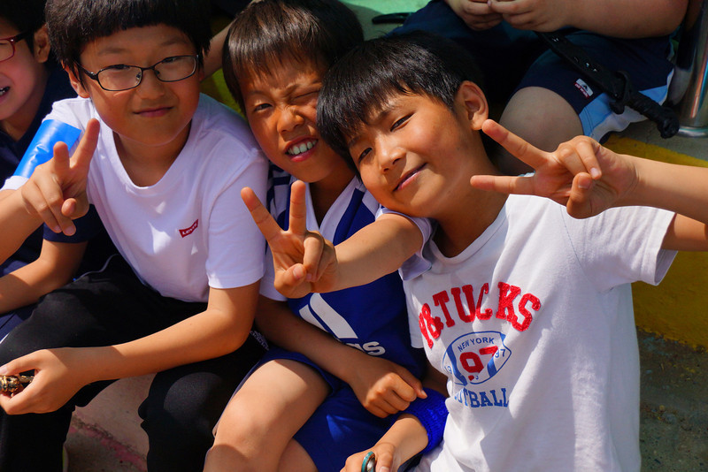 A group of Korean boys pose for the camera.