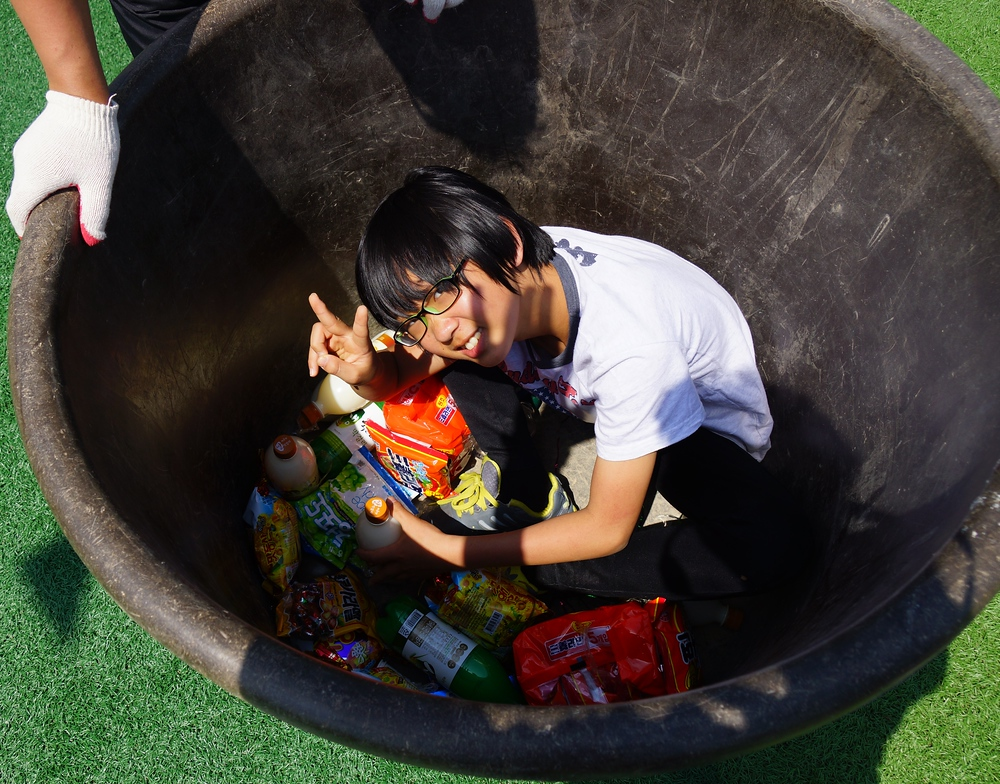 A Korean boys hides in a garbage can for an event.