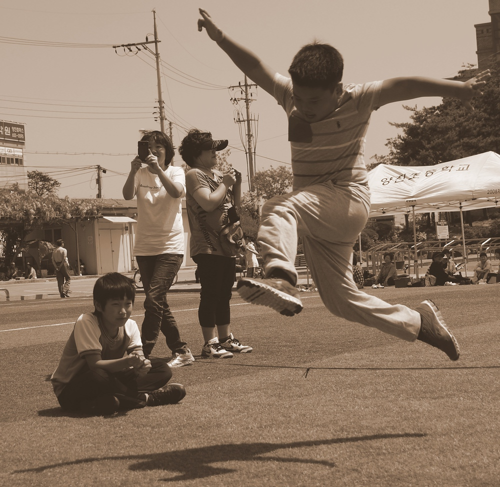 A Korean elementary school student shows fine form with this jump.