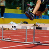 An action shot of a Korean student in clearing a hurdle.