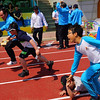 A Korean mother takes a tumble during a race with her son.