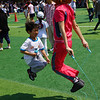 A Korean mother and her son enjoy jump-rope together.