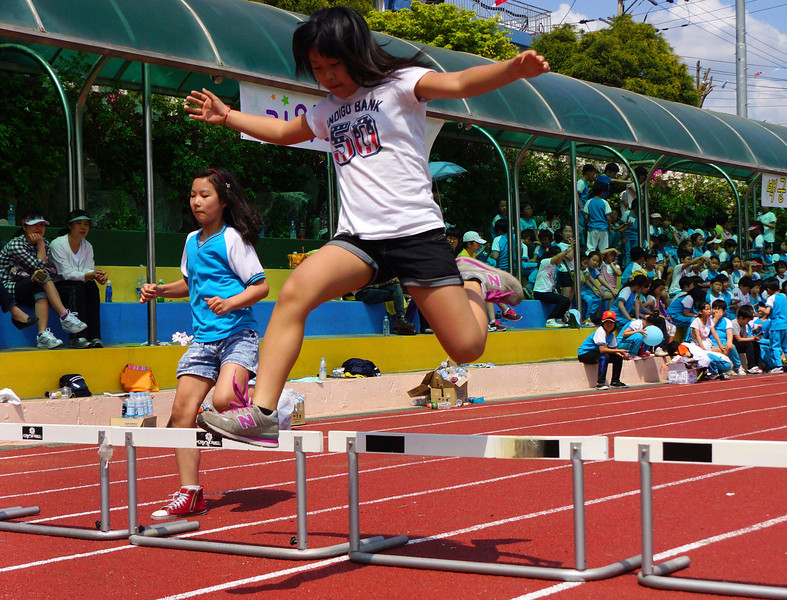 A Korean elementary student leaps.