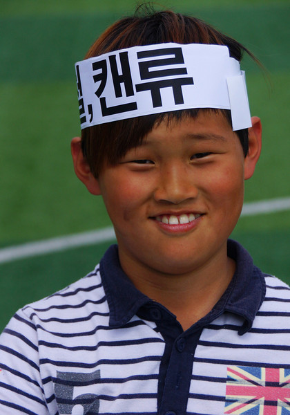 A Korean boy smiles.