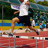 A shot of Korean girl clearing a hurdle.