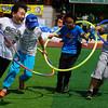 Some Korean boys enjoy a relay event.