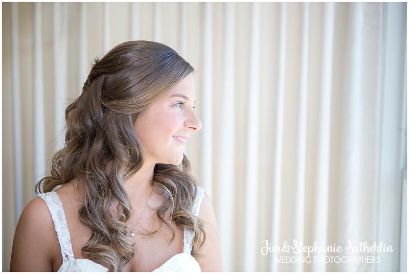 Bride Gazes Out Window