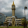 Clocktower/rocketship in Kota Bharu, between giant Qurans on pedestals.
