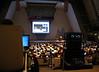 At the conference. The impressive industrial strength projector on the right provided bright image at huge distance.<br /> <br /> Na konferencji. Zwroccie uwage na duzy projektor po prawej - wlasnie on wyswietla obraz na ekranie.