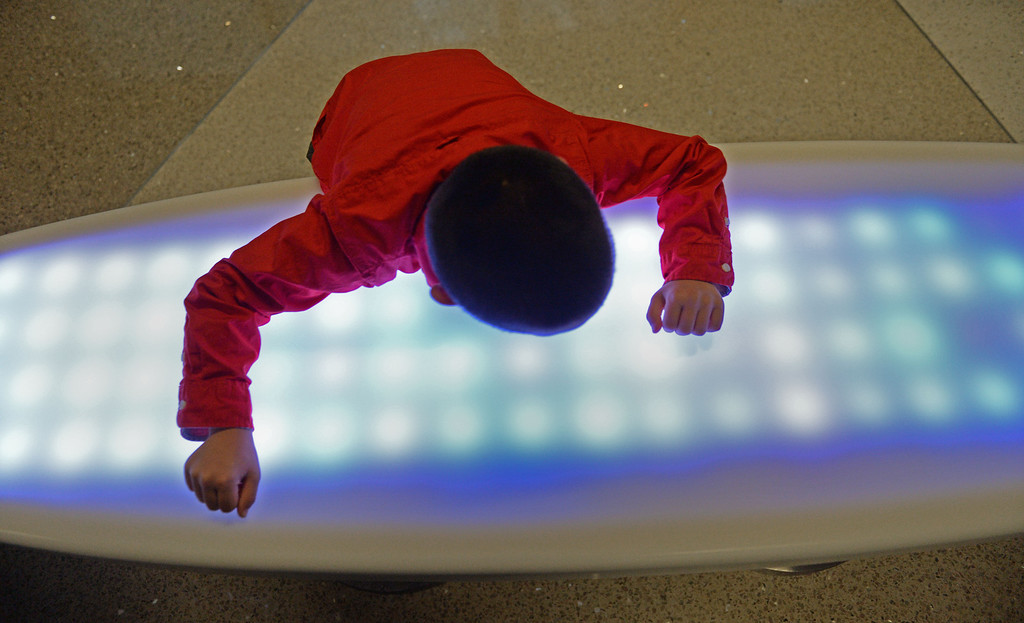 . At LAX, a new play space for kids age 2-8 opened inside the new Tom Bradley International Terminal. A lighted surfboard table was fun for Jack Martin, 7.  (Dec 19, 2013. Photo by Brad Graverson/The Daily Breeze)
