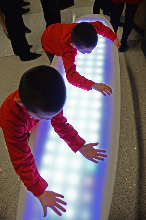. At LAX, a new play space for kids age 2-8 opened inside the new Tom Bradley International Terminal. A lighted surfboard table was fun for Charlie and Jack Martin, both 7.  (Dec 19, 2013. Photo by Brad Graverson/The Daily Breeze)