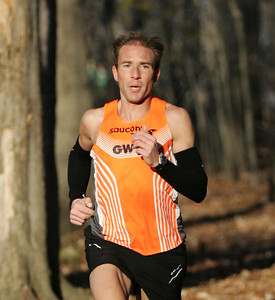 Vince Maloney, former Amherst runner, is in first place in the woods of the LCCC Turkey Trot course nearing the first mile mark. photo by Ray Riedel