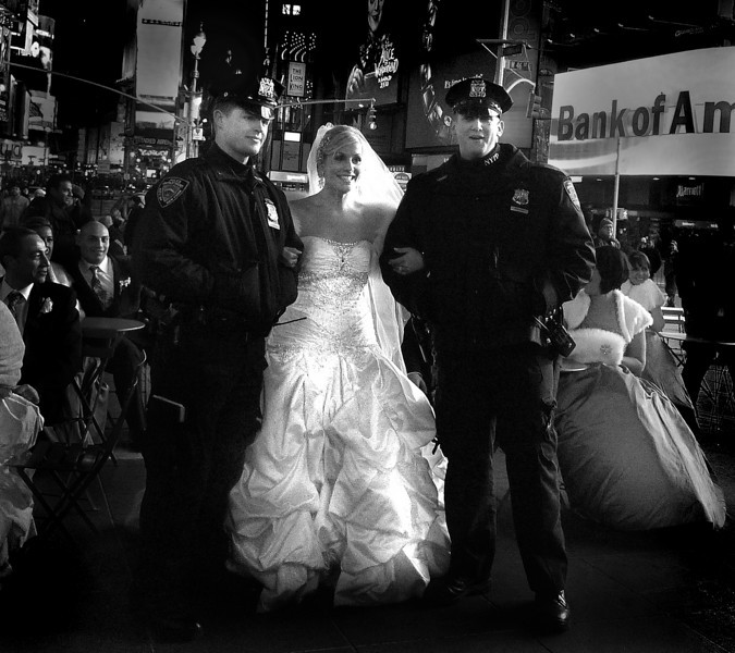 Times Square Wedding. 25 degerees Farenheit- Wedding Reception right out there- 2 Local Cops for protection-Where else but New York? Leica -De-lux 4.