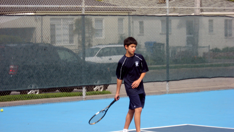Number 2 Singles Stephan L follows through during warm-ups at ND HS in Sherman Oaks.