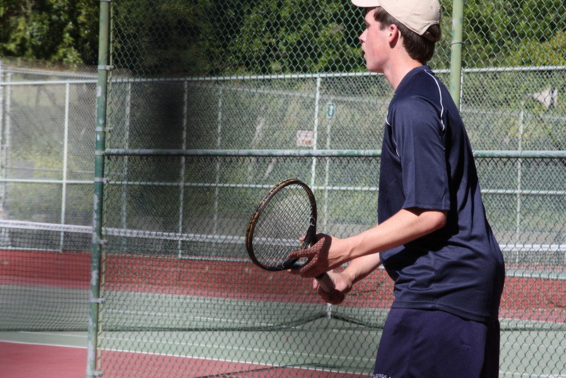 Team Captain Shea M waits for his opponent's serve versus Crespi.   Photo by Peter Arnold.