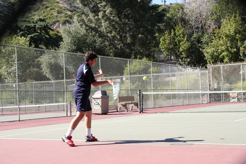 Cyrus J gets a bead on a blistering forehand return.    Photo by Peter Arnold