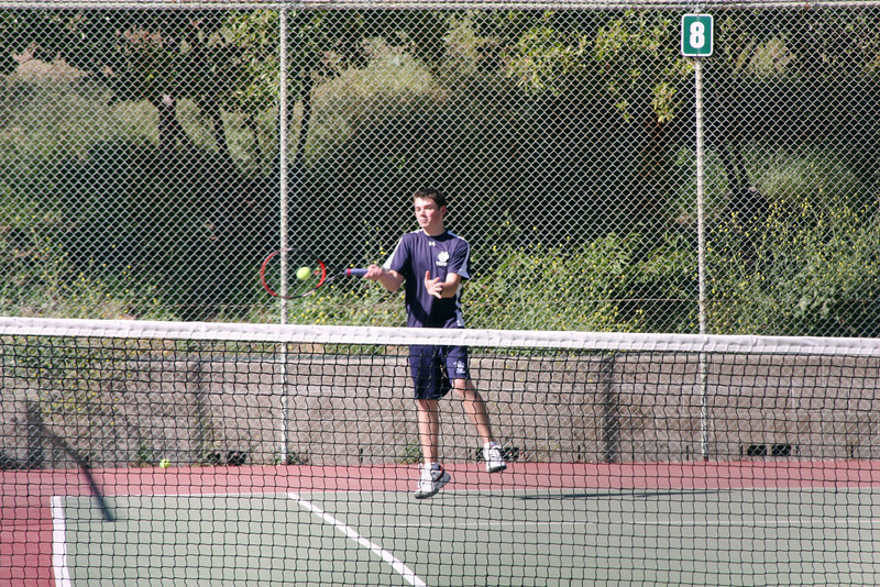 Vincent CF hits a cross-court winnner.   Photo by Peter Arnold.
