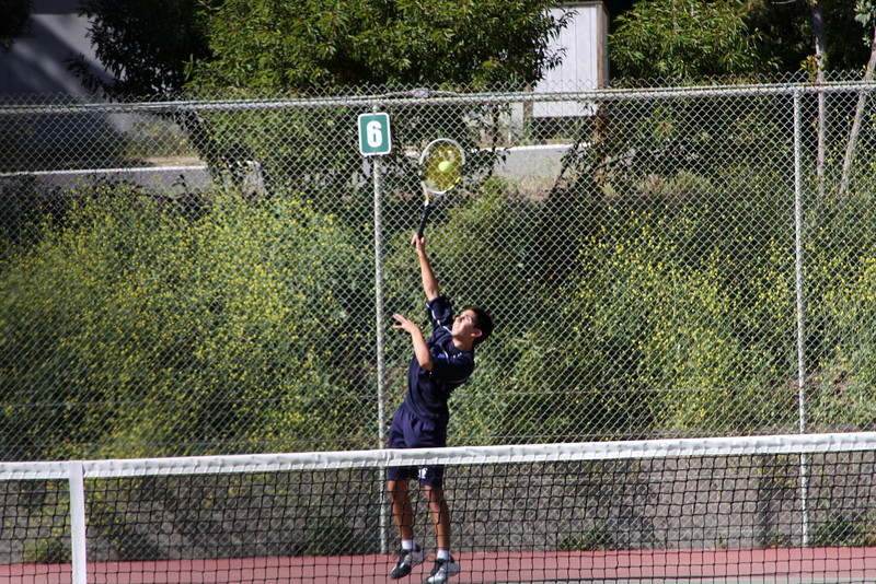 Michael K has his serve lined up for an ace versus Crespi.  Photo by Peter Arnold