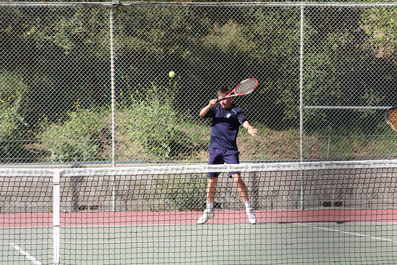 Griffin C puts a topspin on forehand winner.  Photo by Peter Arnold