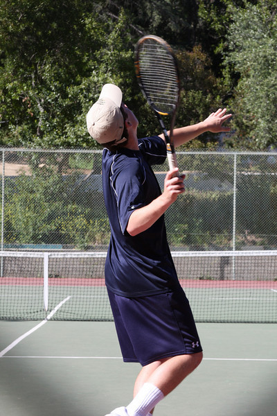 Now it's Shea's turn to blister the opponent with his cannon of a serve...  Photo by Peter Arnold