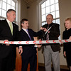 J.S.CARRAS/THE RECORD Developer Auri Kaufman helps Cohoes Mayor George Primeau, Sr., with scissors to cut ribbon Thursday, January 16, 2014 at Lofts of Harmony Mills West in Cohoes, N.Y..