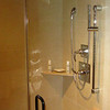 An elegant shower replaces the tub.