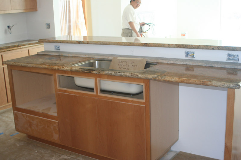 5/14/06. Kitchen island w/granite counter tops installed.