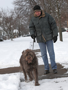 03Feb13___John Goetz of Elyria takes his Labradoodle, Sophie, for walk on Sunday morning in Eastern Heights neighborhood of Elyria. photo by Ray Riedel