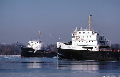 The RACE . . . as seen from Windsor, Ontario two sister steamers of differing companies downbound with their last loads of the season in December of 1980, the Angus suffering boiler problems is over taken by the Golden Hind - both laid up and neither ran again both sold for scrap.