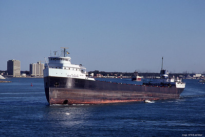 """Ford Motor Company steamer John Dykstra upbound pumped way out for an """"elevated"""" ride to the iron ore docks on Lake Superior."""