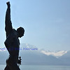Bronze statue erected in honour of Freddie Mercury on the shore of Lake Geneva, Switzerland at Montreux, where he lived for many years. In the background the french alps