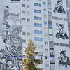 mural artwork on a building in Switzerland of the actor Charlie Chaplin from the film Modern Times