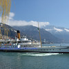 a pleasure paddle steamer at Montreux on Lake Geneva in Switzerland, with the bernese alps in the background