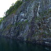 A huge, long, vertical granite wall along the east side of the lake