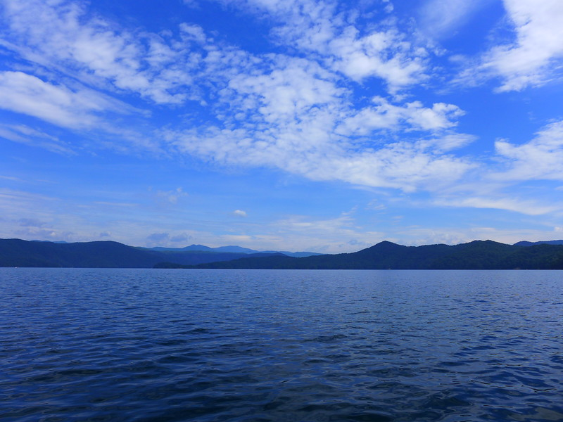 Sky, Clouds, Mountains, and Lake