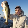 Brian Gay with a 4 lb largemouth freshwater bass, caught on a shiner from Lake Toho, Florida, November 2010.