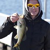 Oliver Gay with a small largemouth freshwater bass