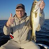 Brian Gay with a 4 lb largemouth freshwater bass, caught on a shiner from Lake Toho, Florida, November 2010.