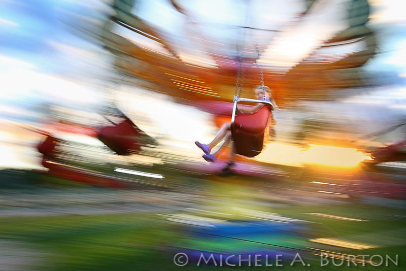 Flying through the air on a carnival ride at Olympia's 59th Annual Lakefair festival, July 13, 2016