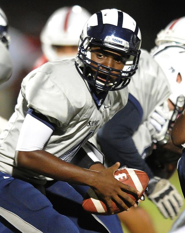 . Mayfair\'s Isaiah Jackson quarterbacks against Lakewood as they play at Bellflower High School for the Milk Bucket Trophy in Bellflower, CA. on September 13, 2013. (Photo by Sean Hiller/Press Telegram)