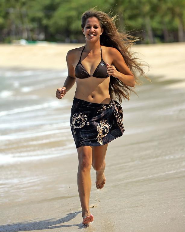 Girl Running on Hulopo'e Beach - Lana'i, Hawaii