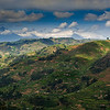 The high degree of utilization of the mountain region of Uganda is illustrated here.  The chain of volcano peaks in the distance form the Virunga range in Rwanda and the Democratic Republic of the Congo.