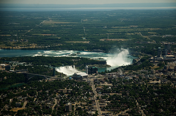 Canadian & American Falls.  City of Niagara in foreground.