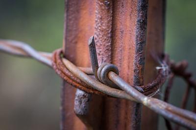 Metal Barb on Fenceposts