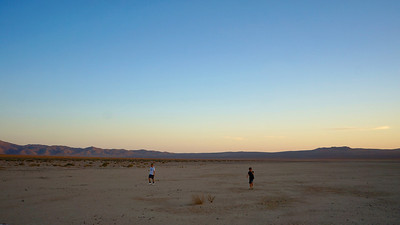 Boys Wander on Dry Lake Bed