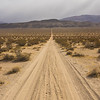 Long Dirt Desert Road to Mountains