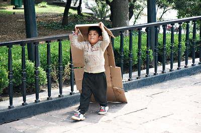 MEXICO CITY - AUGUST 8, 2008: A young homeless boy wanders the streets of Mexico City, Mexico.